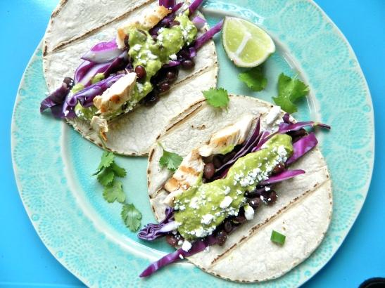 Chicken + Black Bean Tacos with Cilantro-Avocado-Lime Sauce via Simply Real Health